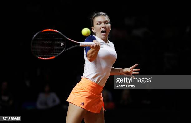 Simona Halep of Romania plays a forehand during her match against Laura Siegemund of Germany during the Porsche Tennis Grand Prix at Porsche Arena on...