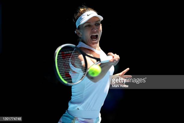 Simona Halep of Romania plays a forehand during her Women's Singles third round match against Yulia Putintseva of Kazakhstan on day six of the 2020...
