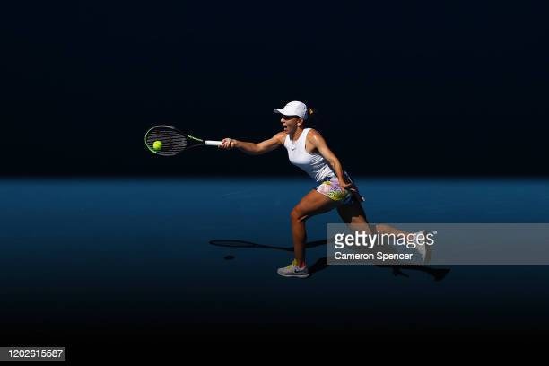 Simona Halep of Romania plays a forehand during her Women's Singles Quarterfinal match against Anett Kontaveit of Estonia on day ten of the 2020...