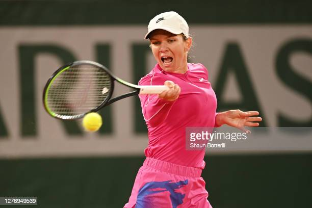 Simona Halep of Romania plays a forehand during her Women's Singles first round match against Sara Sorribes Tormo of Spain during day one of the 2020...