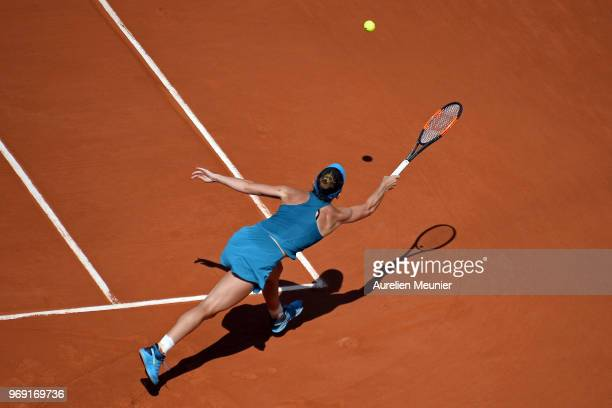 Simona Halep of Romania plays a forehand during her women's singles semifinal match against Garbine Muguruza of Spain on day 12 of the 2018 French...