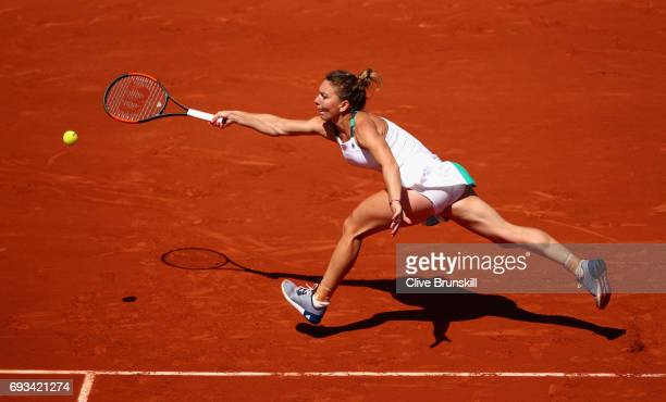 Simona Halep of Romania plays a forehand during ladies singles quarter finals match against Elina Svitolina of Ukraine on day eleven of the 2017...