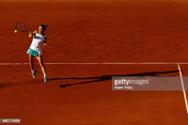 Simona Halep of Romania plays a forehand during the ladies singles first round match against Jana Ceepelova of Slovakia on day three of the 2017...