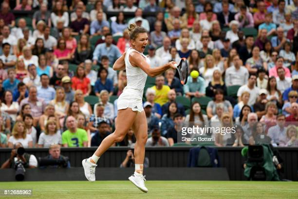 Simona Halep of Romania plays a forehand during the Ladies Singles quarter final match against Johanna Konta of Great Britain on day eight of the...