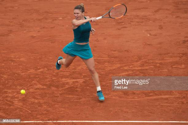 Simona Halep of Romania plays a forehand during the ladies singles quarter finals match against Angelique Kerber of Germany during day eleven of the...