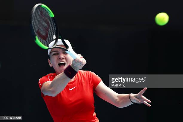 Simona Halep of Romania plays a forehand in her 2nd round match against Ashleigh Barty of Australia during day four of the 2019 Sydney International...
