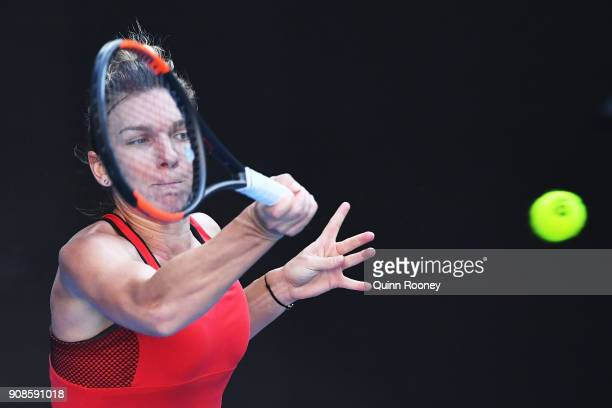Simona Halep of Romania plays a forehand in her fourth round match against Naomi Osaka of Japan on day eight of the 2018 Australian Open at Melbourne...