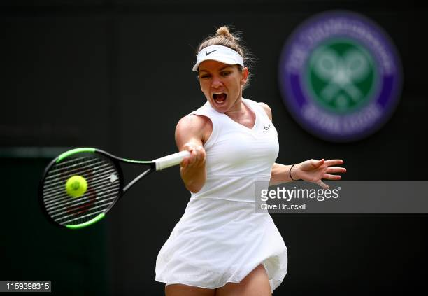 Simona Halep of Romania plays a forehand in her Ladies' Singles first round match against Aliaksandra Sasnovich of Belarus during Day one of The...