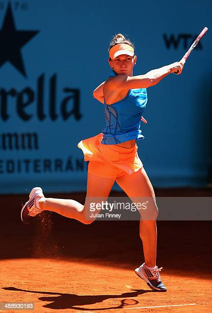 Simona Halep of Romania plays a forehand in her match against Ana Ivanovic of Serbia during day seven of the Mutua Madrid Open tennis tournament at...