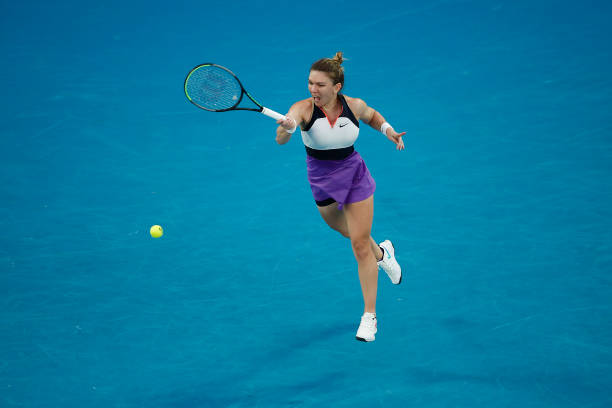 Simona Halep of Romania plays a forehand in her Women's Singles Quarterfinals match against Serena Williams of the United States during day nine of...