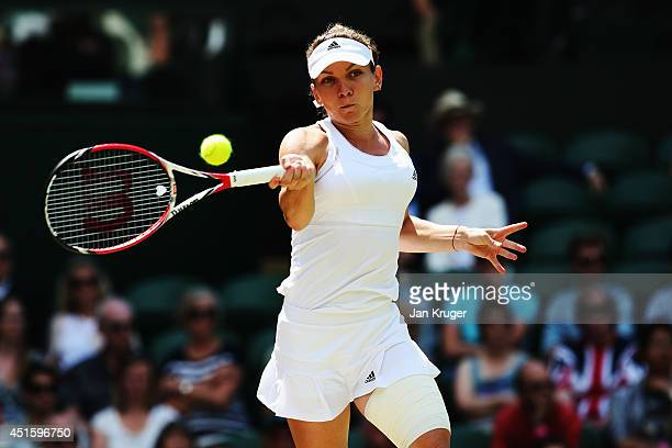 Simona Halep of Romania plays a forehand return during her Ladies' Singles quarterfinal match against Sabine Lisicki of Germany on day nine of the...
