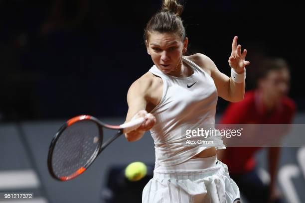 Simona Halep of Romania plays a forehand to Magdalena Rybarikova of Slovakia during day 3 of the Porsche Tennis Grand Prix at PorscheArena on April...