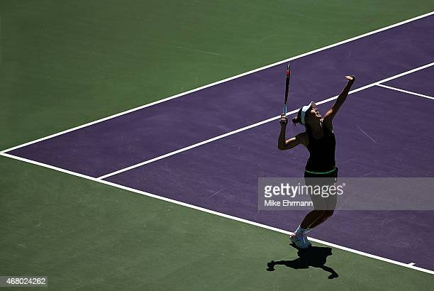 Simona Halep of Romania plays a match against Camila Giorgi of Italy during Day 7 of the Miami Open presented by Itau at Crandon Park Tennis Center...