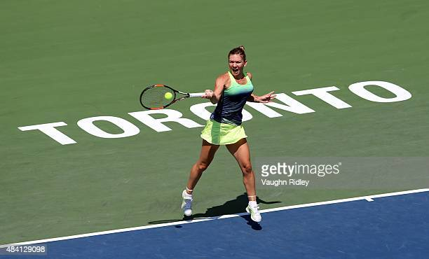 Simona Halep of Romania plays a shot against Sara Errani of Italy during Day 6 of the Rogers Cup at the Aviva Centre on August 15 2015 in Toronto...