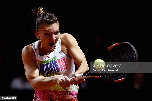Simona Halep of Romania plays backhand in her match against Laura Siegemund of Germany during Day 4 of the Porsche Tennis Grand Prix at PorscheArena...