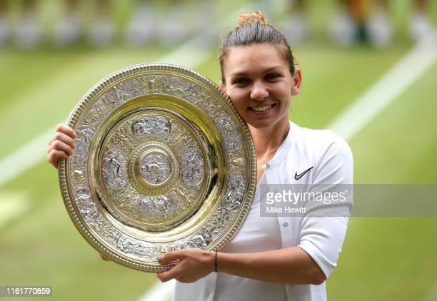 Simona Halep of Romania pose for a photo with the trophy after winning the Ladies' Singles final against Serena Williams of The United States during...
