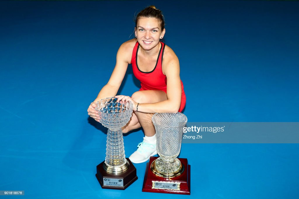Simona Halep of Romania poses for photo with her Single's and Double's Champion trophies during Day 7 of 2018 WTA Shenzhen Open at Longgang International Tennis Center on January 6, 2018 in Shenzhen, China.