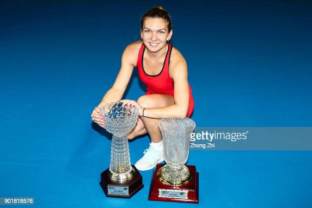 Simona Halep of Romania poses for photo with her Single's and Double's Champion trophies during Day 7 of 2018 WTA Shenzhen Open at Longgang...