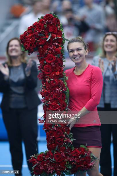 Simona Halep of Romania poses with a bouquet after becoming world number one due to winning the Women's singles semifinals match against Jelena...