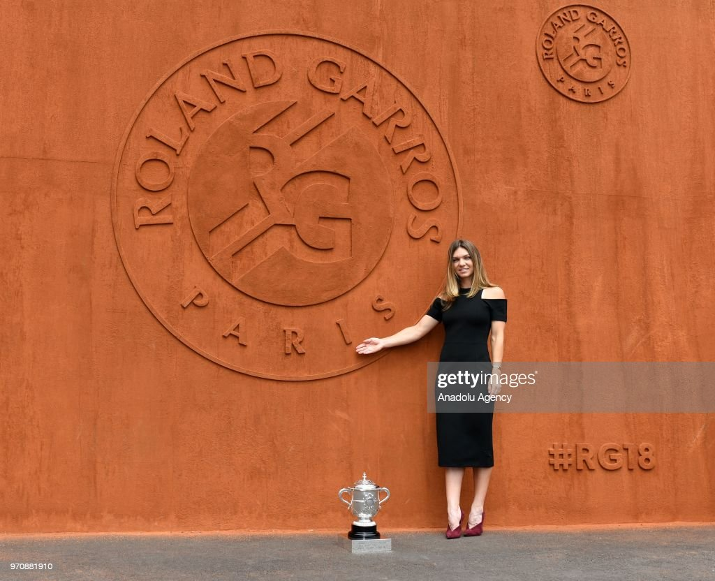 Simona Halep of Romania poses with championship trophy after winning her French Open finals match against Sloane Stephens (not seen) of the USA at Roland Garros Stadium in Paris, France on June 10, 2018.