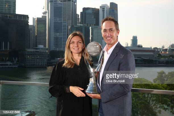Simona Halep of Romania poses with her coach Darren Cahill after winning the Chris Evert WTA World No1 trophyÊfor her achievement of securing theÊWTA...