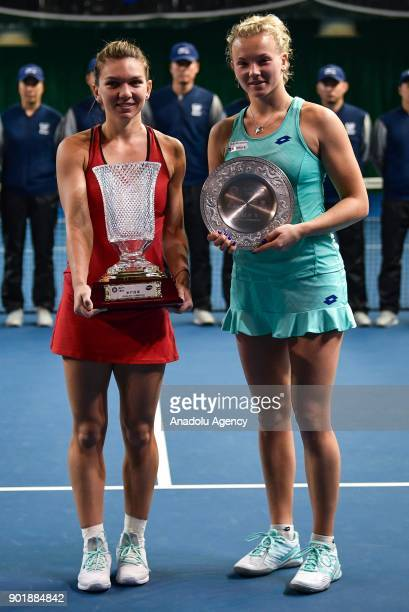 Simona Halep of Romania poses with her trophy after winning the 2018 WTA Shenzhen Open single finals against Katerina Siniakova of Czech Republic at...