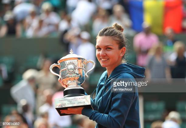 Simona Halep of Romania poses with the trophy after her Women's Singles Final match against Sloane Stephens of United States during day fourteen of...
