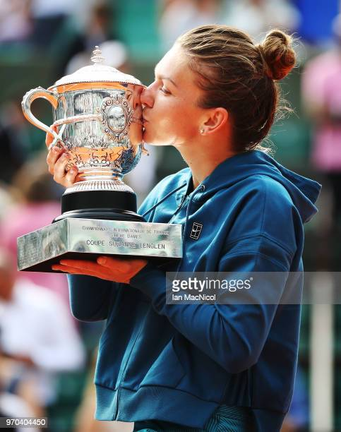 Simona Halep of Romania poses with the trophy after winning the Women's Singles Final match against Sloane Stephens of United States during day...