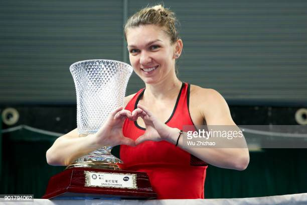 Simona Halep of Romania poses with trophy after winning her final match against Katerina Siniakova of the Czech Republic on Day 7 of 2018 WTA...