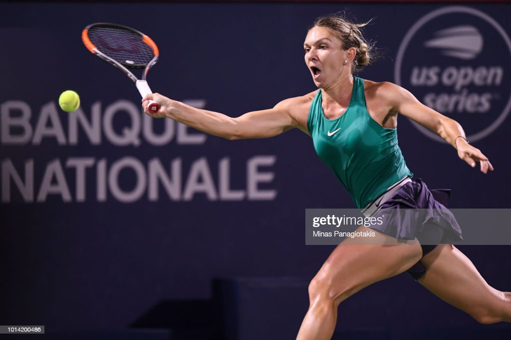 Simona Halep of Romania prepares to hit a return against Venus Williams during day four of the Rogers Cup at IGA Stadium on August 9, 2018 in Montreal, Quebec, Canada.