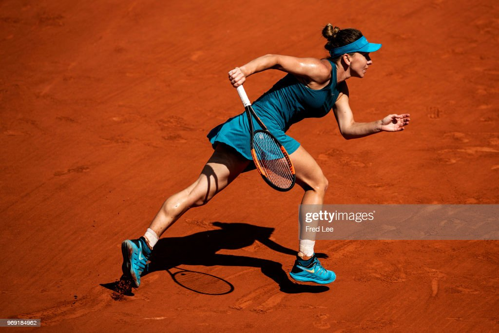 Simona Halep of Romania prepares to return during the ladies' singles semi-final match against Garbine Murguruza of Spain during day twelve of the 2018 French Open at Roland Garros on June 7, 2018 in Paris, France.