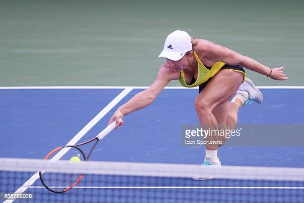 Simona Halep of Romania reaches to hit a forehand during a match in the Western & Southern Open at the Lindner Family Tennis Center in Cincinnati, OH.