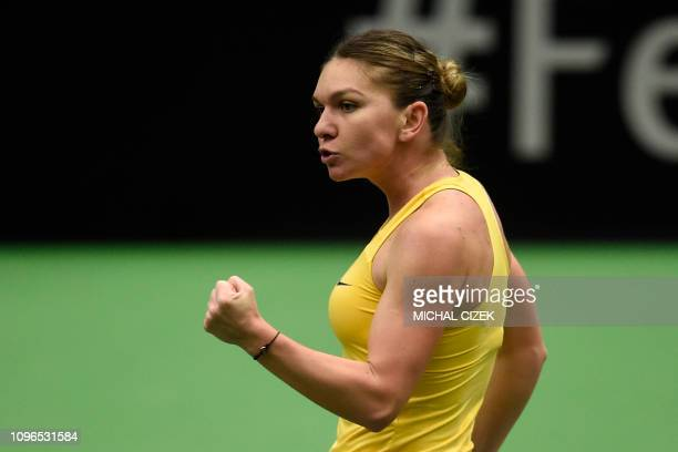 Simona Halep of Romania reacts after a point against Katerina Siniakova of Czech Republic during their first round match at the Fed Cup tennis...