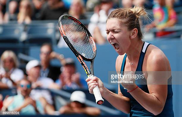 Simona Halep of Romania reacts after defeating Carla Suarez Navarro of Spain during her fourth round Women's Singles match on Day Eight of the 2016...