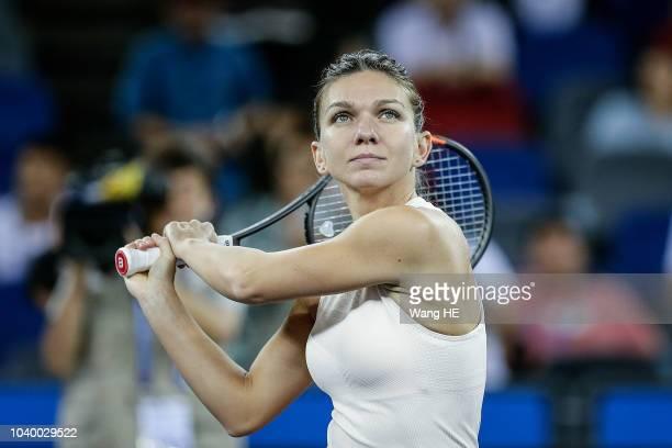 Simona Halep of Romania reacts against Dominika Cibulkova of Slovakia during 2018 Wuhan Open at Optics Valley International Tennis Center on...