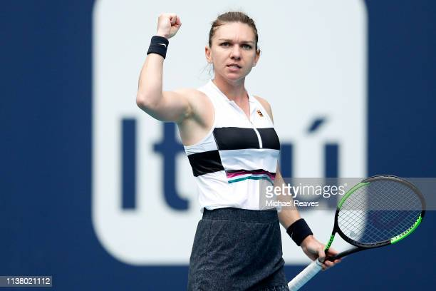 Simona Halep of Romania reacts during her match against Polona Hercog of Slovenia during Day 7 of the Miami Open Presented by Itau at Hard Rock...