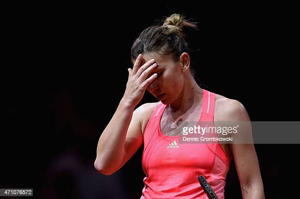 Simona Halep of Romania reacts during her semi final match against Caroline Wozniacki of Denmark during Day 6 of the Porsche Tennis Grand Prix on...