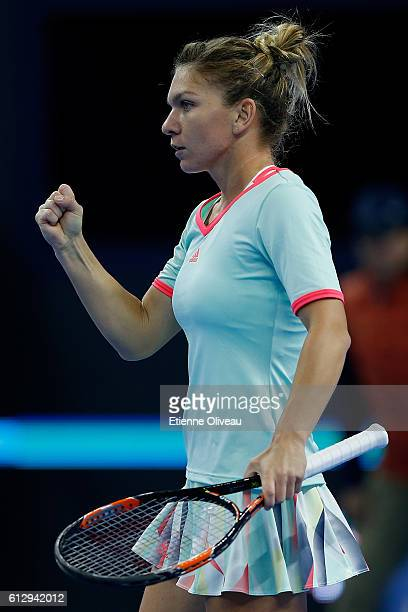 Simona Halep of Romania reacts during the Women's singles third round match against Zhang Shuai of China on day six of the 2016 China Open at the...