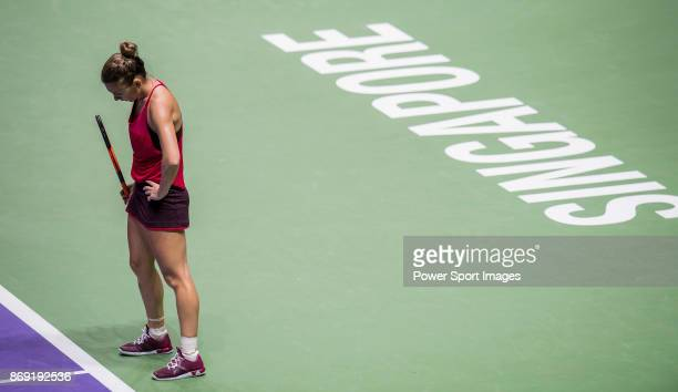 Simona Halep of Romania reacts in her singles match against Elina Svitolina of Ukraine during the BNP Paribas WTA Finals Singapore presented by SC...
