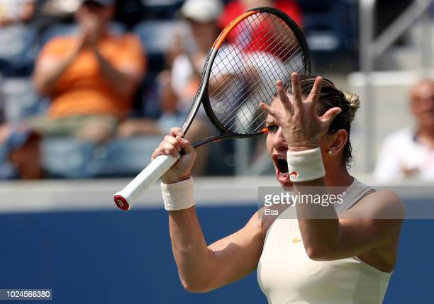 Simona Halep of Romania reacts in her women's singles first round match against Kaia Kanepi of Estonia on Day One of the 2018 US Open at the USTA...