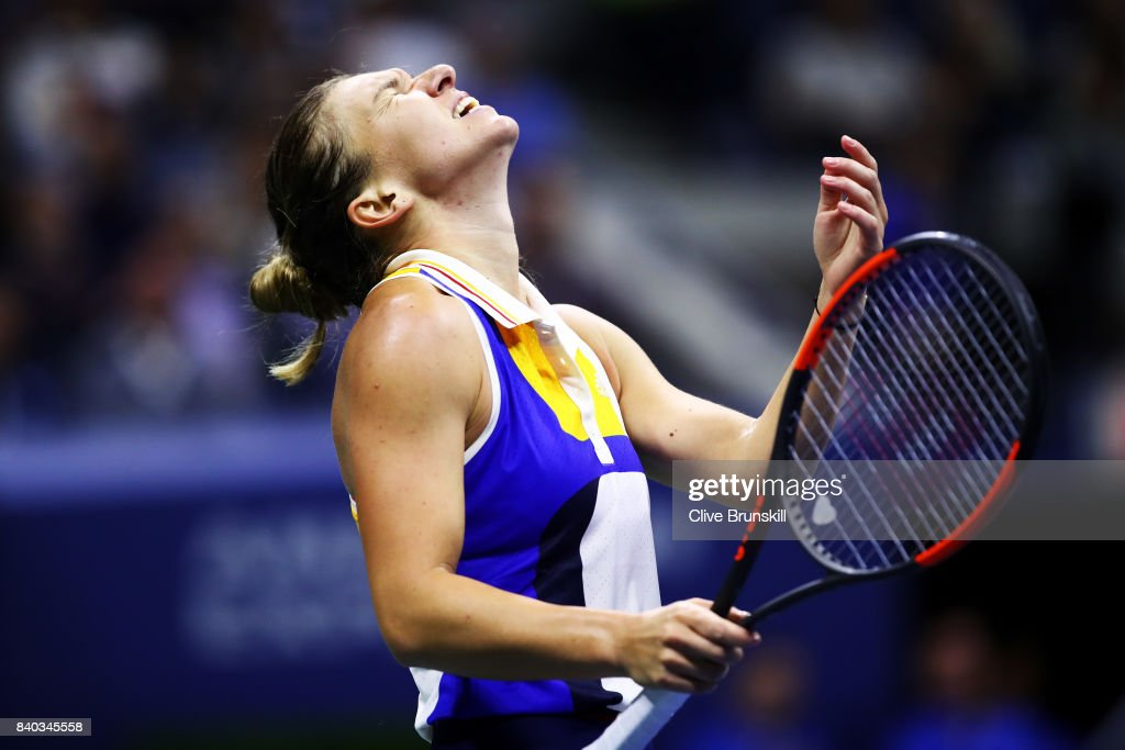 Simona Halep of Romania reacts in the her first round Women's Singles match loss to Maria Sharapova of Russia on Day One of the 2017 US Open at the USTA Billie Jean King National Tennis Center on August 28, 2017 in the Flushing neighborhood of the Queens borough of New York City.