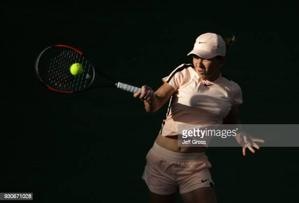 Simona Halep of Romania returns a forehand to Caroline Dolehide during the BNP Paribas Open on March 11, 2018 at the Indian Wells Tennis Garden in...