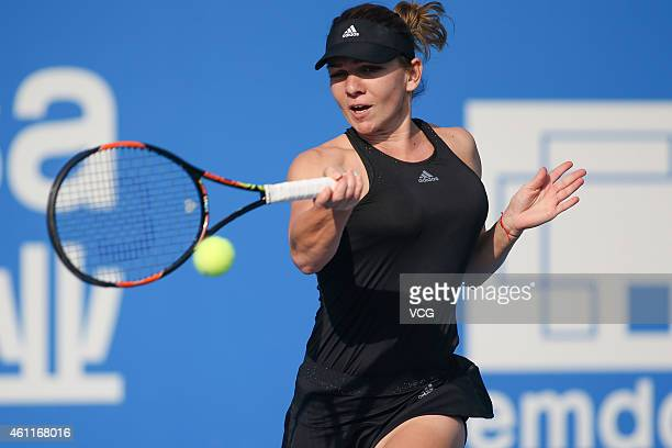 Simona Halep of Romania returns a shot against Aleksandra Krunic of Republic of Serbia on day five of WTA Shenzhen Open at Longgang Sports Center on...