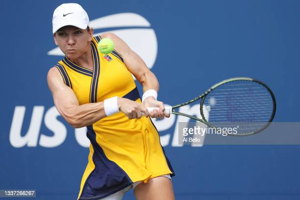 Simona Halep of Romania returns a shot against Camila Giorgi of Italy during their women's singles first round match on Day One of the 2021 US Open...