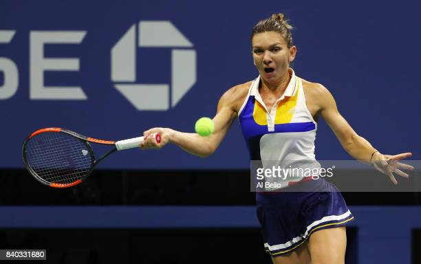 Simona Halep of Romania returns a shot against Maria Sharapova of Russia during her first round Women's Singles match on Day One of the 2017 US Open...