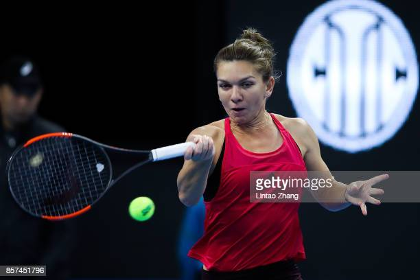 Simona Halep of Romania returns a shot against Maria Sharapova of Russia during the Women's singles 3rd round on day five of 2017 China Open at the...