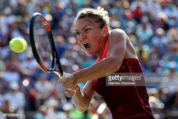 Simona Halep of Romania returns a shot against Sabine Lisicki of Germany during their Women's Singles Fourth Round match on Day Eight of the 2015 US...