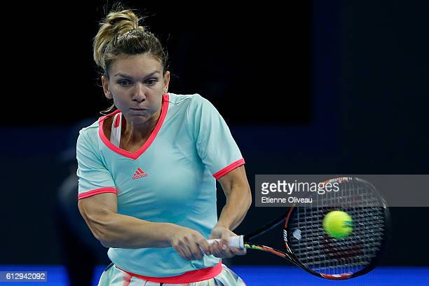 Simona Halep of Romania returns a shot against Zhang Shuai of China during the Women's singles third round match on day six of the 2016 China Open at...