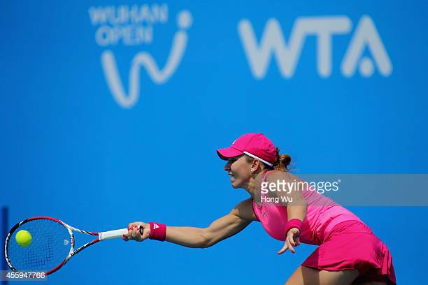Simona Halep of Romania returns a shot during her match against during day three of the 2014 Dongfeng Motor Wuhan Open at Wuhan Optics Valley...