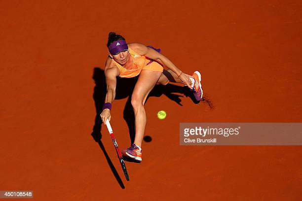 Simona Halep of Romania returns a shot during her women's singles match against Andrea Petkovic of Germany on day twelve of the French Open at Roland...